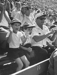 """Desi Arnaz cheers on the Dodgers while sitting next to his young son, Desi Jr., and child actor Richard Keith who played """"Little Ricky"""" on I Love Lucy, 1958."""