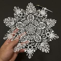 Japanese artist Mr. Riu creates detailed papercuts of extraordinary complexity that are all cut entirely by hand using a craft knife