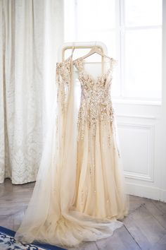 "Gorgeous + glamorous sparkly gold wedding dress: <a href=""http://www.stylemepretty.com/little-black-book-blog/2016/01/04/french-chateau-wedding-sparkly-gold-dress/"" rel=""nofollow"" target=""_blank"">www.stylemepretty...</a> 