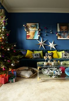 the beauty of the styling of this living room is that the christmas twists stay true