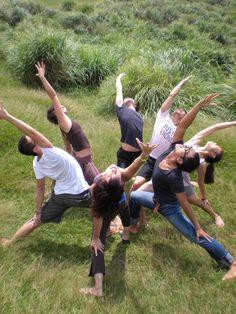 beautiful yoga group reverse warrior