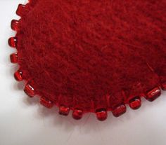 felted red wool beaded hearts