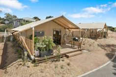 Located along the Great Ocean Road, these safari tents have all the creature comforts of home while creating an unforgettable holiday experience. Go Glamping, Outdoor Baths, Holiday Park, Creature Comforts, Vic Australia, Porch Swing, Safari, Shed, Outdoor Structures