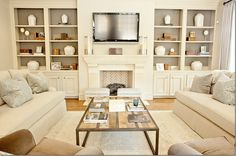 Beautiful living room by Munger Interiors via Cote de Texas.  Love the shelves with the back painted a pretty grey and how the TV is mounted but doesn't distract from the beautiful room!