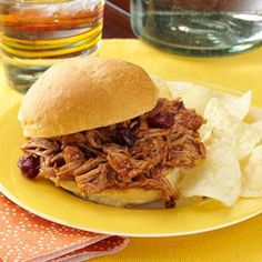 "CRANBERRY BBQ PULLED PORK RECIPE: ~ From: ""Taste Of Home.Com"". ~ Recipe Courtesy Of: ""CARRIE WIEGAND - Mt. Pleasant, Iowa. ~ Cranberry sauce adds a yummy twist on traditional pulled pork my family can't get enough of! The pork cooks to tender perfection in the slow cooker, which also makes this dish conveniently portable."