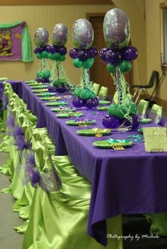 Green and purple decorated table at a Princess and the Frog birthday party! See more party ideas at CatchMyParty.com!