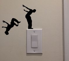 Two Men Jumping Back Flip Off Light Switch 5x5.6 by DecalPhanatics