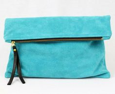 This turquoise-colored oversized fold clutch provides an exciting jolt of vibrancy on a night out. www.mooreaseal.com