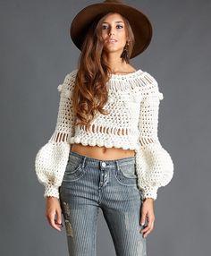 Jersey de lana crudo con mangas farol. Composición 100% lana