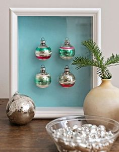Ornament Shadowbox: Old glass ornaments are timeless and very fragile, maybe even too fragile to hang on the Christmas tree. Line a shadowbox with colored craft paper and affix your ornaments with double sided tape to create your own Christmas art.