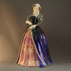 Mary Queen of Scots Qu Realms LE Royal Doulton Figurine  This Royal Doulton figurine was designed by P. Parsons and is 9 inches or 22.9 cm in height. Mary Queen of Scots was issued in 1989 in a limited edition of 5000. She is wearing a blue and purple dress and is part of the Queens of the Realm