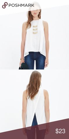 Madewell Flyaway Tank PRODUCT DETAILS Swingy and simple in the front and flirtatious in the back, with a split panel for a peekaboo reveal. EDIT: just noticed some very faint, tiny stains! Listing has been temporarily deactivated until I can add a photo. ☺️  Drapey fit. Cotton. Machine wash. Madewell Tops Tank Tops
