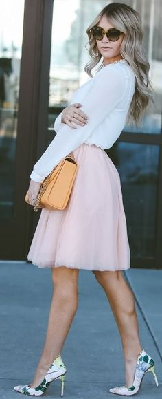 White blouse + pink tulle skirt.