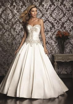 An exquisite ball gown in rich satin. The strapless bodice features a sweetheart neckline and flattering ruching while Swarovski crystals encrust the entire bodice. The ball gown skirt is features box pleats and is finished with a chapel length train and a lace-up back.