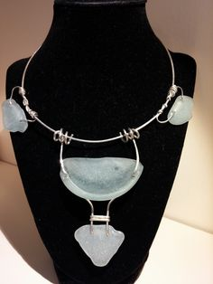 "Sea Glass Jewelry, ""Bottoms Up"" Sterling silver choker with aqua sea glass. Large piece of sea glass is the bottom of a bottle and has a small lip. Choker measures 17"" and the sea glass extends 3.5"" from the wire. $100. Won Judges Recognition at the Broward Art Guild in December 2014 show."