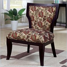 "Coaster Accent Chair in Oblong Pattern Brown Cappuccino - Relax in style with this oblong patterned accent chair with a large seating area and tapered cappuccino legs. Features: Attached Back V shaped upholstered back with wood border Plush upholstered chair seat Tapered wood legs Specifications: Overall Product Dimensions: 35"" H x 28"" W x 28.5"" D Weight: 35.2 lbs"