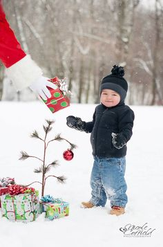 holiday winter session with santa and presents - Christmas toddler outdoor snow photography
