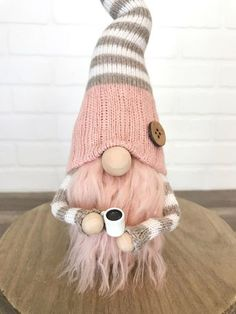 Pink and tan coffee gnome.  Adorable gnome with a little cup of coffee.