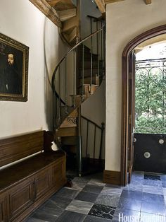 A corkscrew staircase in the foyer of a 1920s Spanish Revival house in Dallas. Design: Dana Oatley Ortego.