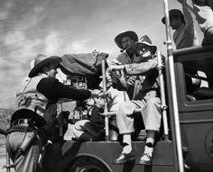 ❦ thescrewballgirl:  John Wayne and John Ford on the set of 3 Godfathers.