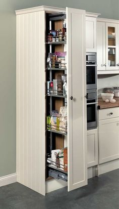 This Awesome Photo of Charming Contemporary Large Pantry Cabinet Photo Ideas is totally great for your idea. Many of our visitors choose this as favourite in Kitchen Category Kitchen Larder Cupboard, Kitchen Pantry Design, Kitchen Cabinetry, Home Decor Kitchen, Interior Design Kitchen, Narrow Kitchen, Pantry Ideas, Furniture Outlet, Discount Furniture