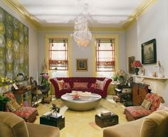Painted yellow trim and crown moulding to repeat the floor and Artwork color unifies the color story…k…Muriel Brandolini design.
