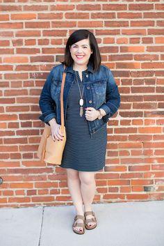 Angela from @headtotoechic in her J.Jill striped ottoman knit dress, tasseled bucket bag, and arizona Birkenstock sandals.