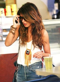 Love her clothes, jewelry, and especially her hair!