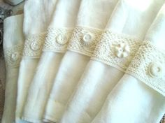 this is a set of 8 antique lace napkin rings (napkins not included). The white lace was sewn onto a piece of wide cream grosgrain ribbon to provide support. Each one is unique with its own white vintage button attached to the front. This white theme is so timeless, and with a vase of colorful fresh spring flowers, your table setting will be stunning!