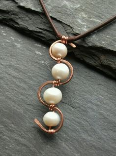 Copper & pearl wire wrapped pendant on leather necklace via Etsy