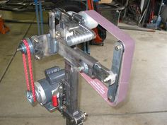 http://www.pirate4x4.com/forum/shop-tools/545417-plans-building-your-own-belt-sander.html
