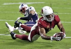 Arizona Cardinals wide receiver Larry Fitzgerald (11) scores a touchdown as New England Patriots cornerback Logan Ryan (26) defends during the first half of an NFL football game, Sunday, Sept. 11, 2016, in Glendale, Ariz. (AP Photo/Rick Scuteri)