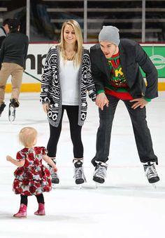 Andrew Shaw and his girlfriend Chaunette play with a staff member's daughter.