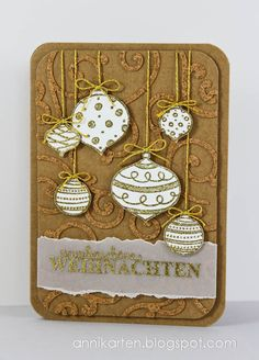 Christmas card...gold embossed baubles on kraft...luv the cork die cut swirls underneath and the vellum torn band for the sentiment....