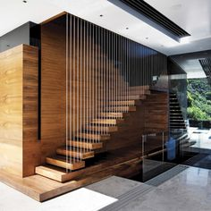 Modern wooden stairs design give a new look to a traditional material and transform a staircase into a piece of art. Wooden stairs are the most popular Cantilever Stairs, Wood Stairs, House Stairs, Stair Railing, Timber Staircase, Open Staircase, Glass Railing, Contemporary Stairs, Modern Stairs