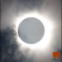 "Total eclipse, Australia November 2012. The clouds have parted long enough to see the solar corona at the time of totality. (SLOOH SpaceCamera - Live Event) ©Mona Evans, ""Solar Eclipses"" http://www.bellaonline.com/articles/art28395.asp"