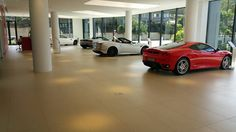 "There is a brand that ""lives next door to us"", that is world-renowned for its aesthetic qualities, eye for detail, technical properties, and design, just like us. We're talking about Ferrari! The Ferrari showroom in Brisbane has used BIANCO Casalgrande Padana tiles (60x120) to emphasise the legendary and inimitable Ferrari red!"