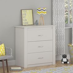 Design a soothing nursery or bedroom with the Cosco Riley 3 Drawer Dresser. Three spacious drawers are perfectly sized to neatly store clothing, extra blankets or accessories. Riley 3 Drawer Dresser requires assembly upon delivery. Three Drawer Dresser, Dresser Storage, Door Storage, Dresser Drawers, Storage Spaces, Storage Ideas, Bar Furniture, Furniture Deals, Bedroom Furniture