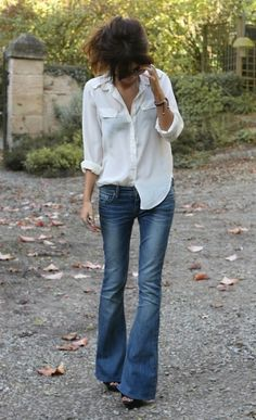 Flared pants look chic with a plain white blouse.  Don't forget the half-tuck-in!
