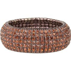 "Stunning Chocolate Gold Tone and Topaz Crystal Stretch Cuff Bracelet Heirloom Finds. $21.99. Will stretch to fit up to a 8"" wrist comfortably. Arrives in Gift Box - Perfect for Gift Giving or Treat Yourself. One of This Season's Hottest Looks. Measures 1"" wide. Sparkling Chocolate Topaz Stretch Bracelet. Save 63% Off!"