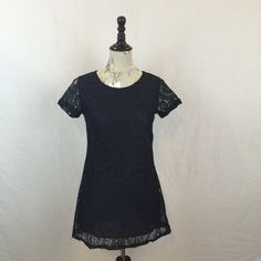 "Navy Lace Minidress NWOT Sexy lace minidress in navy. Fully lined this dress is sure to stop traffic! Features crew neck with button in the back, short sleeves, and ultra short length! Measures 30"" shoulder to hem, 34"" bust, 32"" waist, 36"" hips. Dresses Mini"