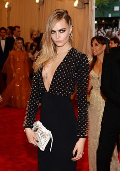 Cara Delevingne Photos Photos - Model Cara Delevingne attends the Costume Institute Gala for the 'PUNK: Chaos to Couture' exhibition at the Metropolitan Museum of Art on May 6, 2013 in New York City. - Red Carpet Arrivals at the Met Gala