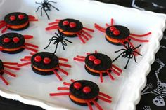 """Red Hots and licorice turn Oreos into creepy (but kinda cute) spiders. Shoestring licorice is hard to find these days, but I did find some here. If you don't want to order online, Twizzlers makes ""Pull-Apart"" candy that works perfectly."""