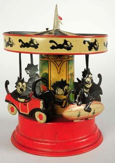 "Vintage Tin Gunthermann Felix Carousel Wind-Up Toy, Made in Bavaria, Nuremberg - Marked ""SG"" for Sam Gunthermann (This is one of the rarest comic character toys ever made and is extremely desirable. This toy is one of only two or three known examples)"