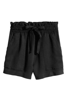 Lyocell shorts: CONSCIOUS. Shorts in a Tencel® lyocell weave with a  high, elasticated drawstring waist and patch front pockets.
