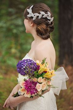 Wedding Updos That Are Beautiful From Every Angle #refinery29  http://www.refinery29.com/bridal-guide/26#slide-11  This is a style that doesn't take itself too seriously and is beautiful to boot....