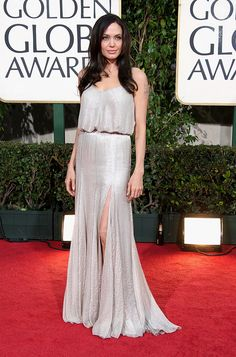Jolie wore this liquid-silver Versace gown to the 66th Annual Golden Globe Awards. via StyleList