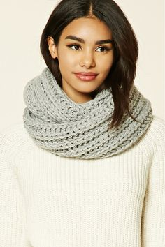 A soft midweight infinity scarf featuring a ribbed knit design.