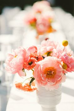 Coral Centerpiece | see full wedding: http://www.stylemepretty.com/2013/07/30/san-francisco-wedding-from-emily-blake