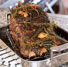 Slow-Roasted Prime Rib. A luxurious centerpiece for a holiday menu, this three-bone prime-rib roast gets heaped with a big pile of smashed garlic, butter, and fresh herbs, then slow-cooked it in a low oven for at least two hours, until the meat becomes meltingly tender, and the herbs and garlic infuse it through and through.